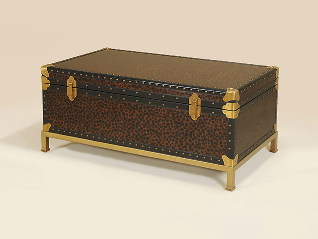 If Additional Storage Is Needed, A Trunk Makes A Wonderful Cocktail Table.  This One Has A Leopard Motif With Leather And Brass Accents.